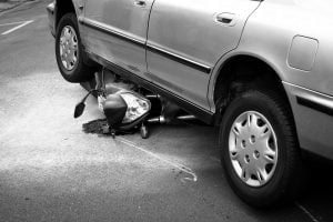 MOTORCYCLE CRASHES NEAR DRIVEWAYS